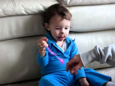 Funny baby eating Nutella chocolate